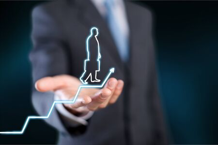 Businessman holding digital glowing graph with silhouette