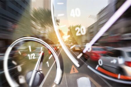 Back lit Speedometer and rev counter dashboard dials illuminated at night in automobile Banco de Imagens