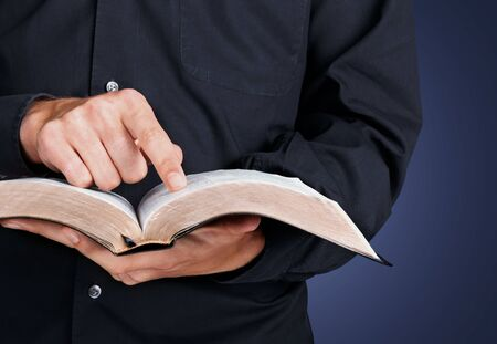 Man reading old heavy book on background Stock Photo