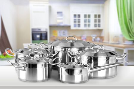 Collection of aluminum pans  on wooden table Stock Photo