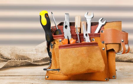 Tool belt with tools on light background