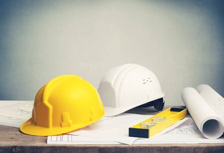 Business engineer contractor concept, builder yellow and white helmet