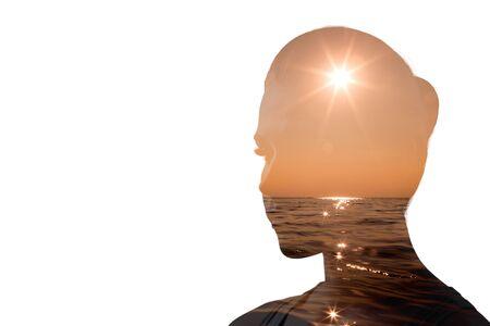 Psychology concept. Sunrise and dreamer woman silhouette. Banco de Imagens