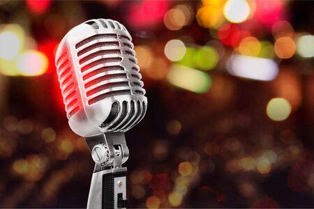 Retro style microphone on bokeh background, music recording. Stockfoto