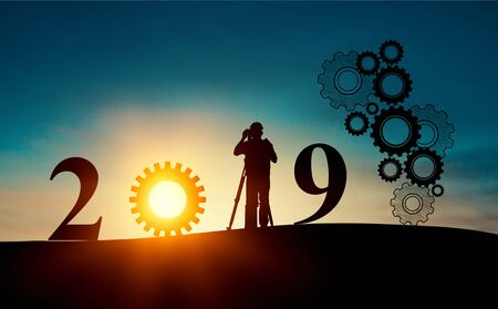 2019 years of robot assistant technology , industry 4.0 , artificial intelligence trend concept. Silhouette of business man control automation robo advisor arm in blur smart building bakckground.          - Image