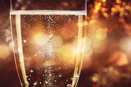 Close up Champagne bubbles in glass on black background