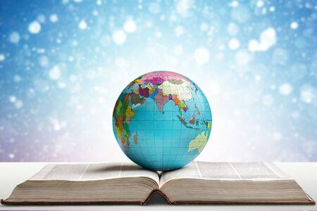 Globe on open book Banco de Imagens