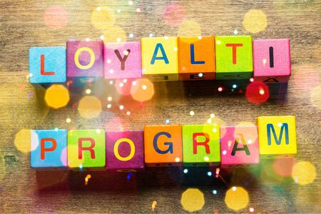 Loyalty Program card with colorful background with defocused lights Stock Photo