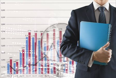 Male businessman with notebook on office background