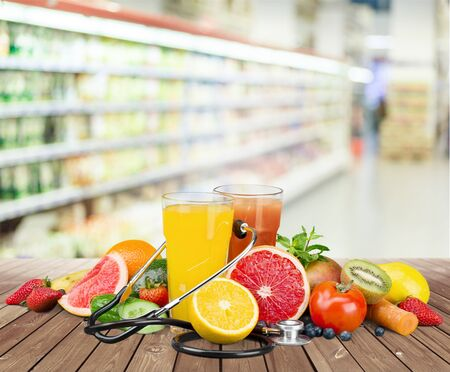 Healthy eating. Fruits, vegetables, juice and stethoscope Stock Photo