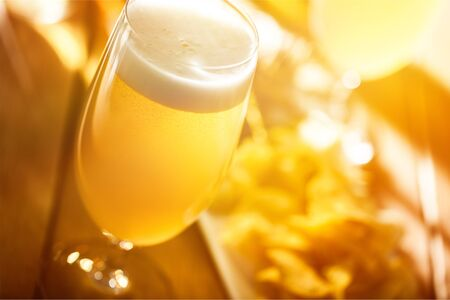 Glass of light beer on background Stock Photo