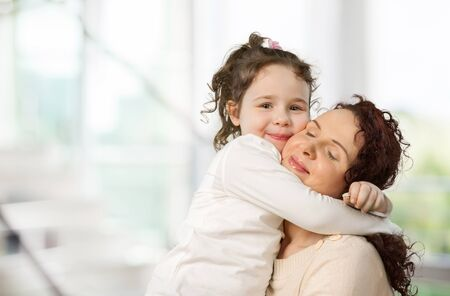 Happy Mother and daughter hugging