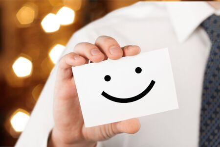 Man holding a business card with happy smiley