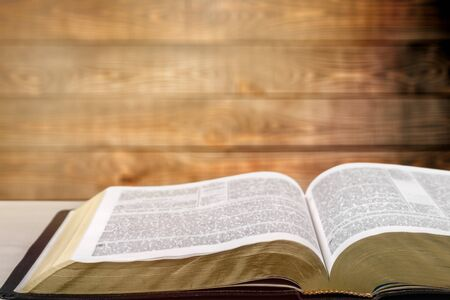 Holy bible with note book and pencil on wooden table against morning  sun light for christian devotion, copy space Foto de archivo - 128026680