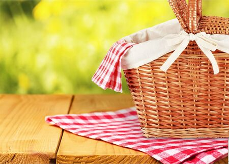 Picnic Basket with napkin om nature background