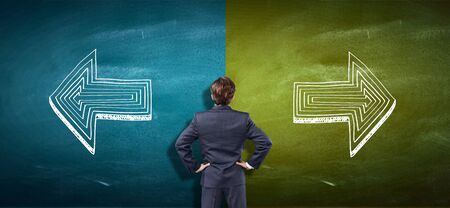 Puzzled businessman and a split blackboard with arrows going in two different ways red and blue side. Correct choice between left and right, failure or success. Difficult decision and doubt concept.          - Image