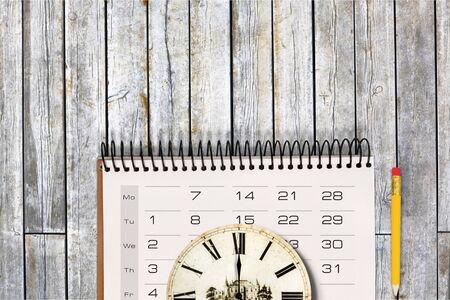 close up of calendar and clock on the green background, planning for business meeting or travel planning concept Stock Photo