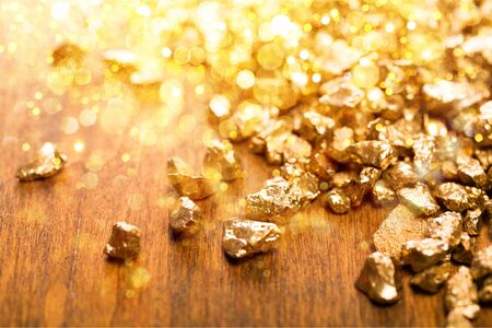 Gold nuggets on background. closeup