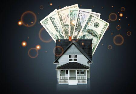 Dollar bills and house model on light background