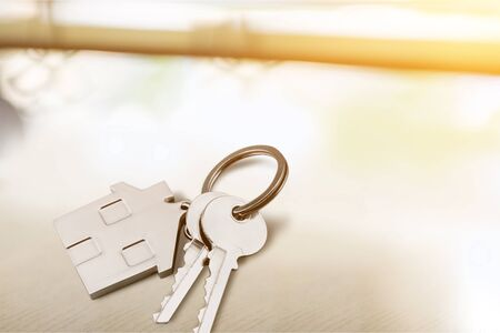 House shaped keychain and keys isolated on white background Stock Photo