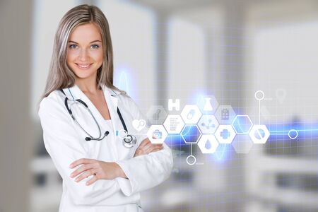 Female doctor with stethoscope in a white coat isolated on white background