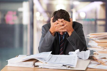 Worker overwhelmed executive working in the office