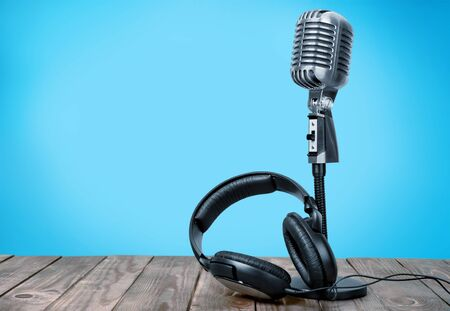 Retro style microphone and headphones on  background Stock Photo