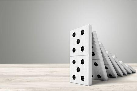 Falling White Dominos