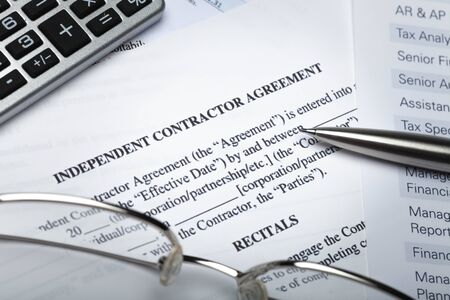 Lease Agreement Documents with Glasses, Pen and Calculator
