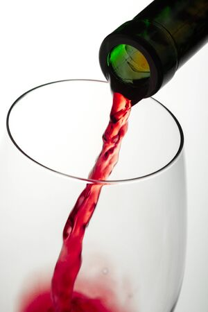 Close-Up of Pouring Red Wine into a Glass