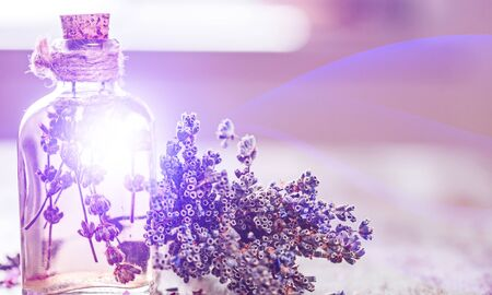 Lavender flowers and glass bottle isolated