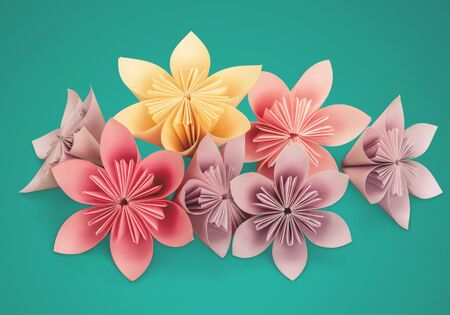 Origami flowers on background