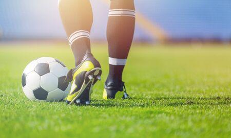 Running soccer player on grass