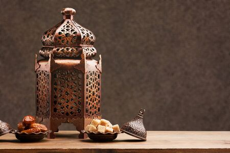 Arabic lantern with candle on table