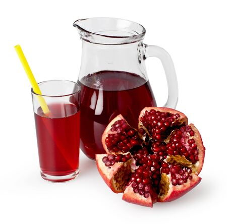 Pitcher and glass of freshly squeezed pomegranate juice