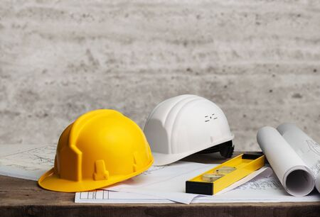 Business engineer contractor concept, hard helmet and blue print