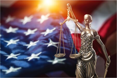 Legal law concept, statue justice on american flag background