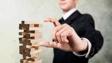 Man playing blocks game, game of physical skill