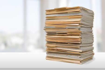 File folders with documents on white table