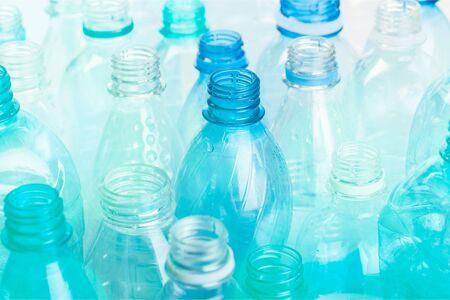 Plastic bottles of water isolated on background Banco de Imagens - 128579983