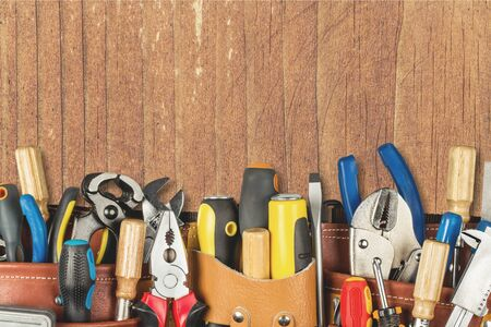 Tool belt with tools on wooden background Stock fotó