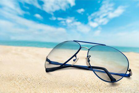 Many sunglasses on sand background. Travel concept Stock fotó