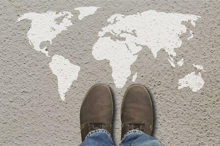 Grey fashion shoes on world map background