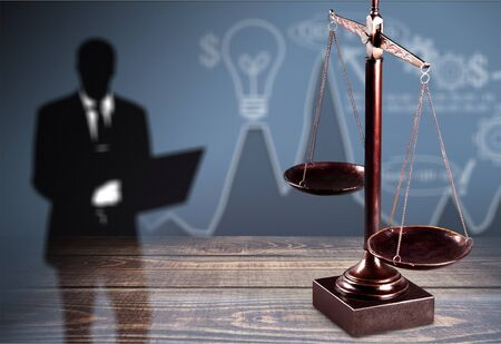 Law scales on table background. Symbol of justice Stockfoto