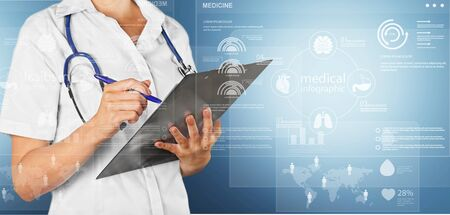 Female doctor holding tablet with blue background and data graphics Banco de Imagens