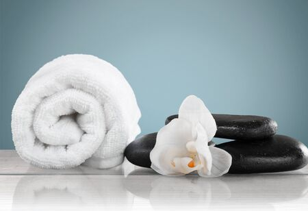 towel, gladiola and pebbles for massage