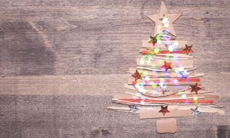 Christmas composition. Christmas tree made of pink ball decoration on pink table background. Flat lay, top view, copy space. New Year sale card. Stock fotó