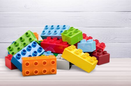 Toy building colorful children building bricks on background
