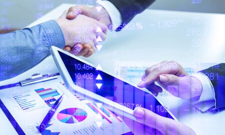 Real estate agent and customers shaking hands together celebrating finished contract after about home insurance and investment loan, handshake and successful deal. Imagens