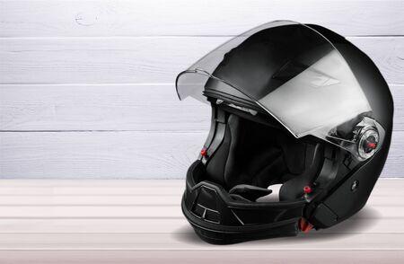 Black biker helmet isolated on white background